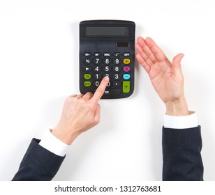 Hands businesswoman and red calculator on black background