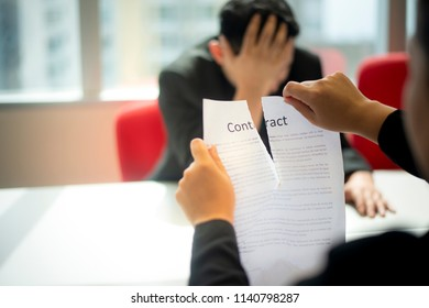 Hands of businesswoman ripping contract agreement paper.Failure business,unemployment and breaking contract deal concept.