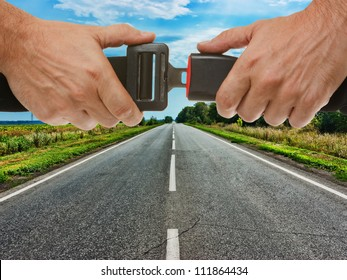 hands button safety belt on the background of the road