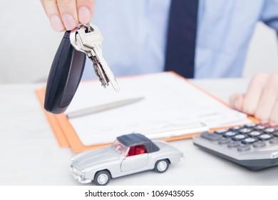 hands with car keys, buy car
