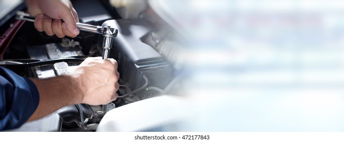 Hands of car mechanic in auto repair service. - Shutterstock ID 472177843