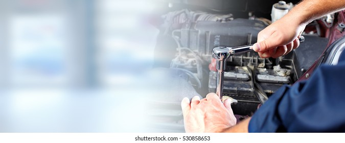 Hands of car mechanic in auto repair service. - Shutterstock ID 530858653