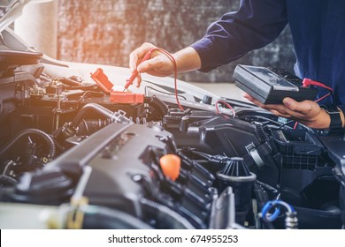 Hands of car mechanic  working in auto repair service.
