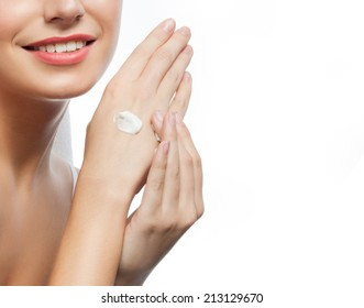 hands care young woman applying cream toothy smile isolated on white studio shot
