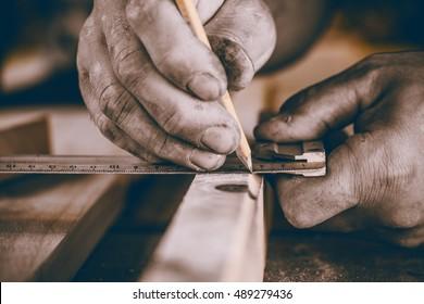 Hands carpenter, measuring work.