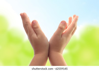 Hands of a child on abstract background