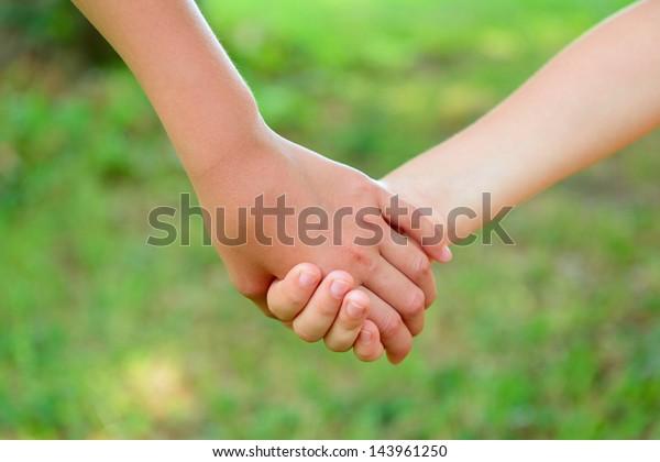 hands of children friends, summer nature outdoor