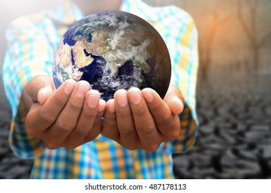 The hands of children to help protect the planet.