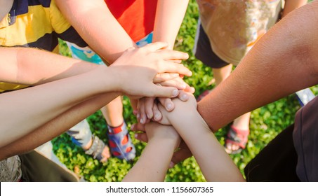 hands of children, many friends, games. Selective focus summer