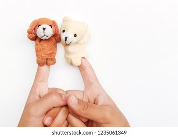 hands of children playing animals fingers puppet isolated on blackground.