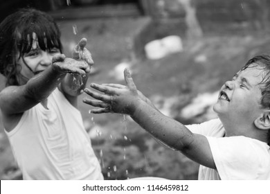Hands of Children in splash water on sunny day. Water shortage, Climate change and Environment concept. Black and white.