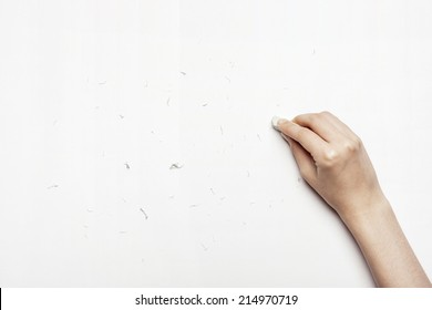 hands cleaning the paper with eraser isolated white.