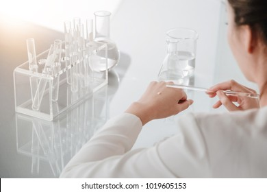 Hands of clinician holding tools scientific experiment in laboratory, Beauty test cream on skin