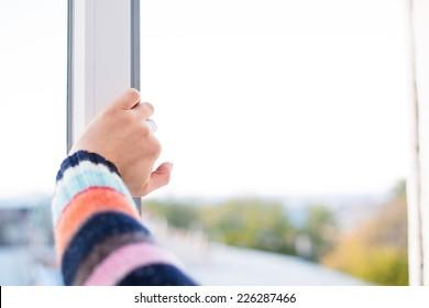 hands close open window