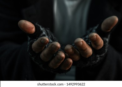 hands close up poor old man or beggar begging you for help sitting at dirty slum. Concept for poverty or hunger people,human Rights,donate and charity