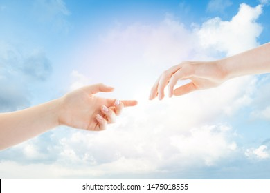 Hands and clouds. Helping, giving and taking hand