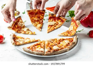 hands of colleague or friends eating pizza, party at home, eating pizza and having fun. People Hands Taking Slices Of Pizza. leisure, food holidays concept.