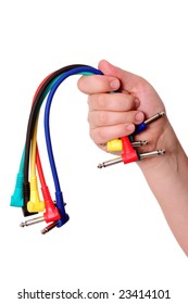 Hands with colored cables over white