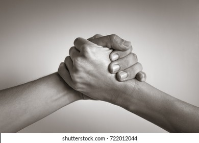Hands coming together, helping hand. People working together, unity, agreement.