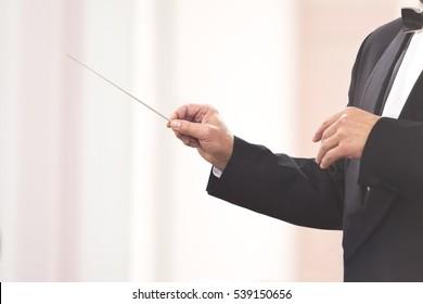 Hands of conductor closeup