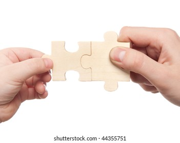 hands connecting puzzles