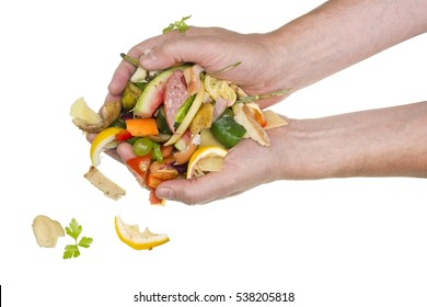 From hands of the cook food waste falls on a table. Isolated studio shot