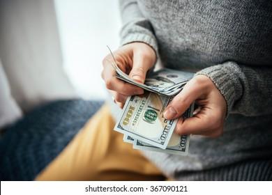 Hands counting us dollar bills
