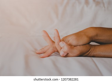 Hands of couple lovers having sex on a bed Passionate couple of two Lover's Morning light in bed at home on holiday concept romantic moments
