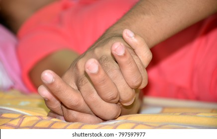 Hands of couple lovers having sex on a bed focus on hand