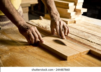 hands of the craftsman cut a piece of wood