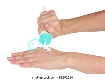 Hands with cream isolated on white