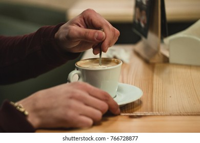 Hands with a cup of coffee, latte, americano