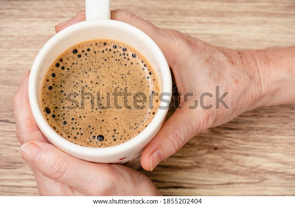 hands-cup-hot-coffee-on-600w-1855202404.
