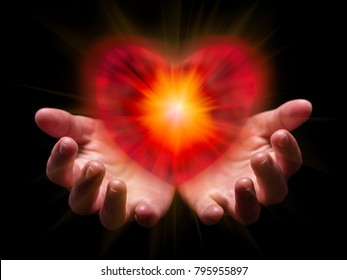 Hands cupped and holding or showing romantic red heart for Valentine or Valentines Day with bright, glowing, shining light. Concept for offering, giving in love, passion, romance. Black background