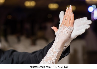 Hands of dancing waltz couple
