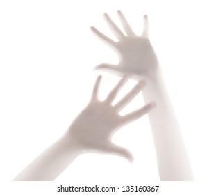 Hands in despair behind a transparent curtain