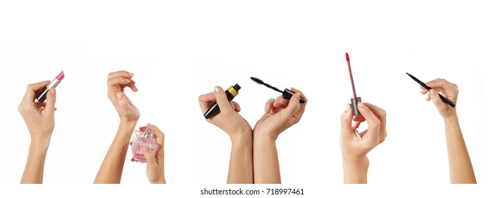 Hands with different makeup products on the white background