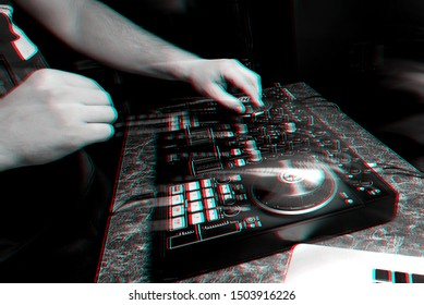 hands DJ playing and mixing music on a modern music controller at a party in a nightclub. Black and white photo with glitch effect and small grain