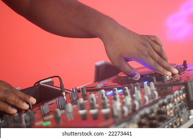 Hands of a DJ spinning some tunes