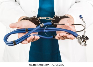 The hands of a doctor, doctors are handcuffed. Medecine, crime, prisoner.