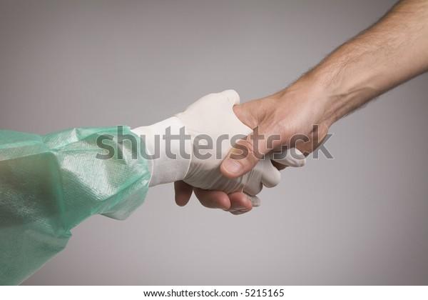 Hands. Doctor and patient handshake.
