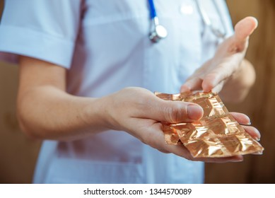 hands of doctor with pills closeup