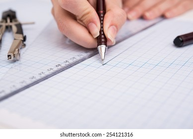 hands drawing graphic on graph paper stock photo edit now