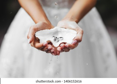 Hands, dressing a wedding ring, rings in the sand, rings on the shell, a ring in the hand of the groom, the feet of the bride and groom, rings on the leg, body parts, hold hands
