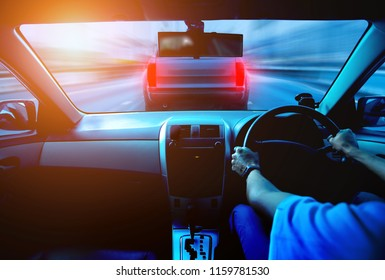 Hands driving a car on the highway. Traffic motion blur. accidents will happen concept.