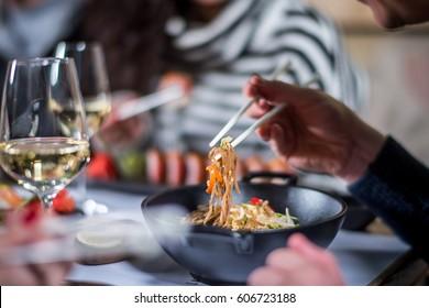 Hands eat noodle with chopsticks