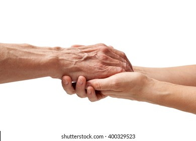Hands of an elderly man holding the hand of a younger woman, isolated white background