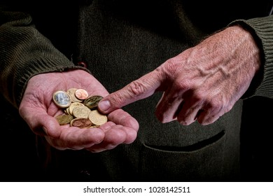 Hands of an elderly person, counting coins