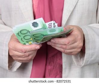 hands of elderly woman with money