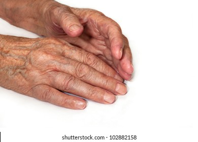Hands of an elderly woman on a white background